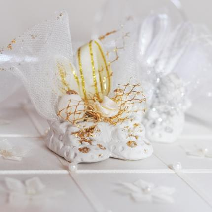 Mini plaster shoes decorated with golden net and glitter, ribbons and ecru tulle