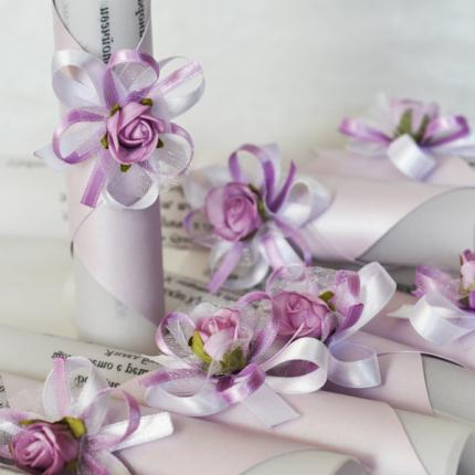Scroll invitations with lilac flowers