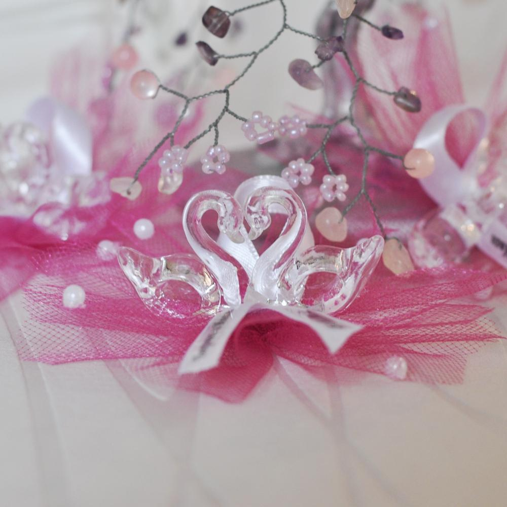 Swans placed on a bed of luscious tulle