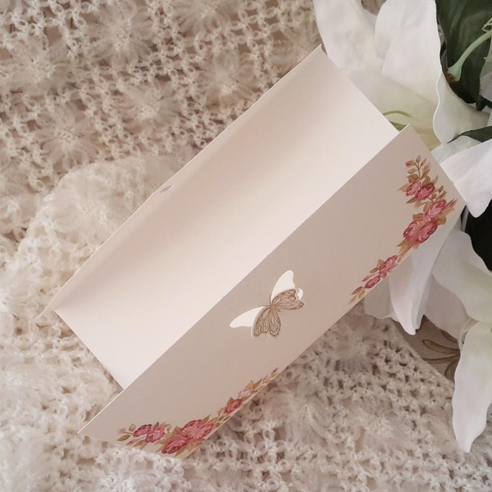 Invitations with lush floral print and butterfly