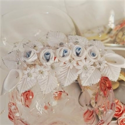 Bridal hair diadem decorated with white roses and Kallas