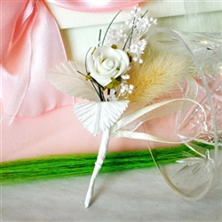 Handmade wedding boutonniere with single white rose
