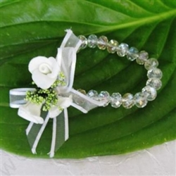 Unique handmade bridesmaid bangle decorated with white satin roses and satin bows