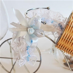 White bridal garter with blue satin ribbon